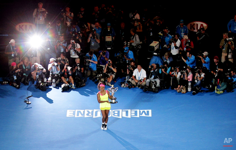 Serena Williams of the U.S. poses the trophy after defeating Maria Sharapova of Russia in the women's singles final at the Australian Open tennis championship in Melbourne, Australia, Saturday, Jan. 31, 2015.
