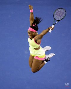 Serena Williams of the U.S. celebrates after defeating Maria Sharapova of Russia in their women's singles final at the Australian Open tennis championship in Melbourne, Australia, Saturday, Jan. 31, 2015.